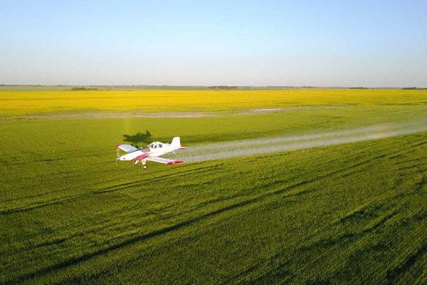 Plane crop dusting